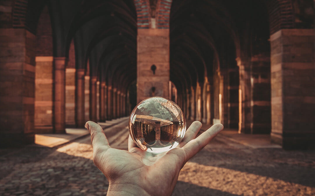 Hand holding small crystal ball