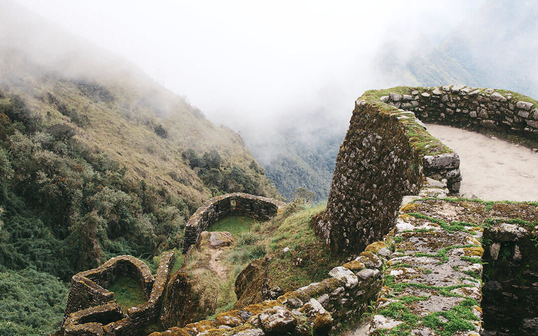 Cobble stone wall ruins and mist