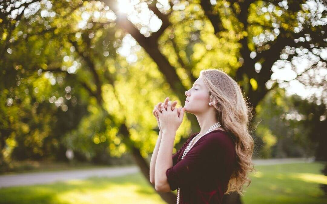 Woman meditating in garden